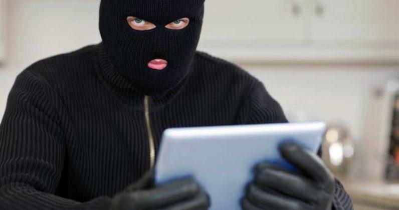 burglar with tablet