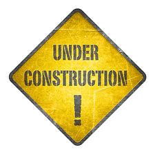 Under construction, yellow sign.jpg