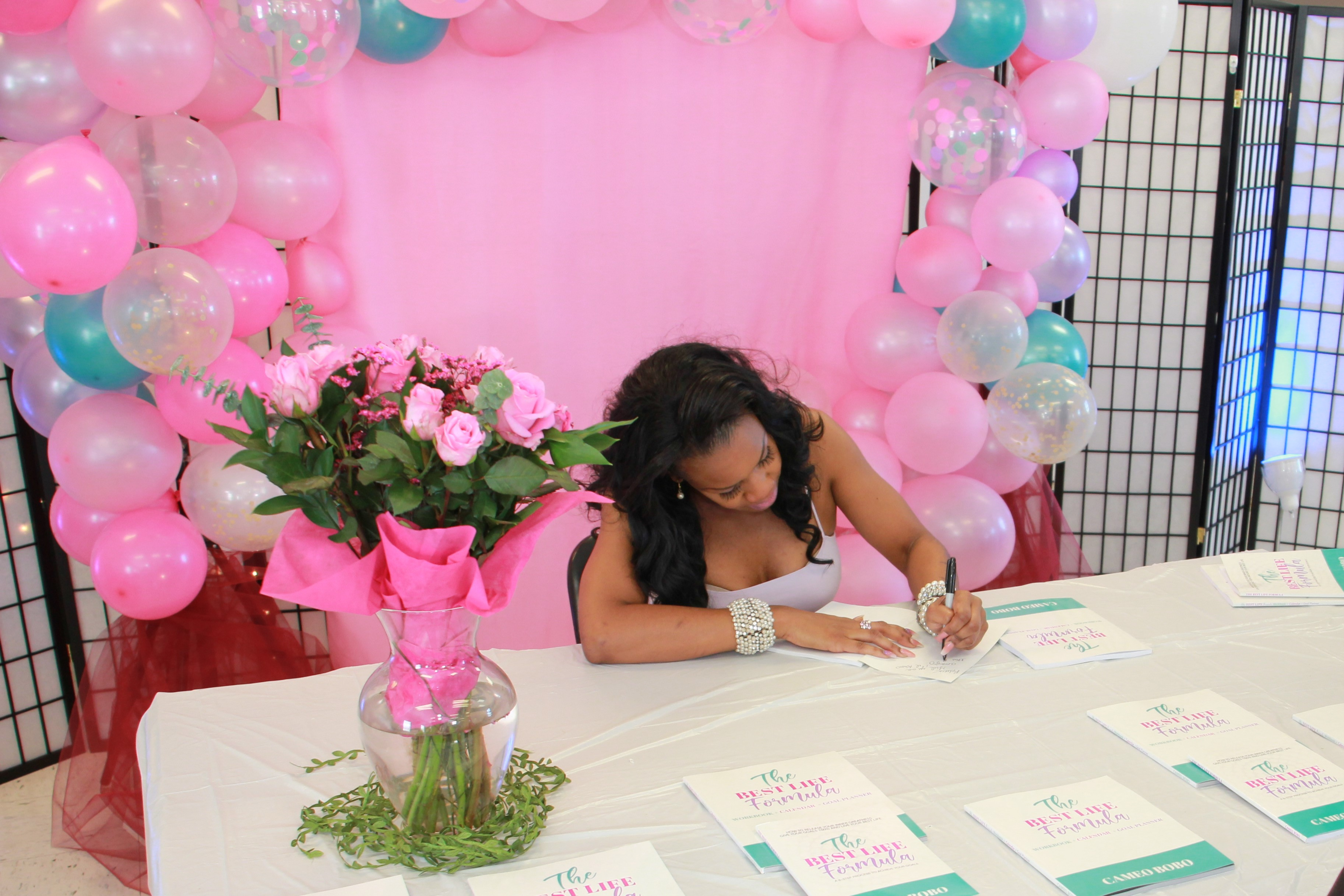 Cameo signing a book