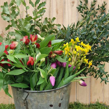 metal bucket of flowers