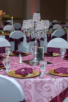 Silver, burgundy, and gold guest table with crystal candelabra