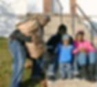 FamilReceivingPotatoesIMG_7048.png