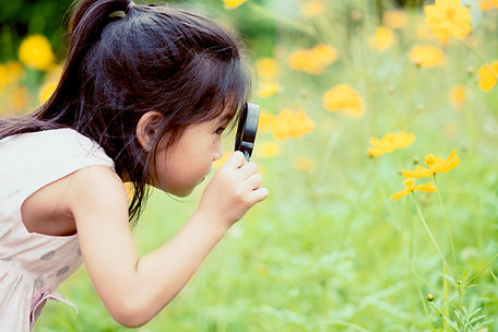 asian-little-child-girl-looking-through-
