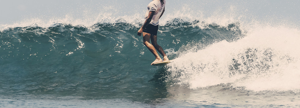 """William Ross on a 9'7"""" Noserider 67' Model."""