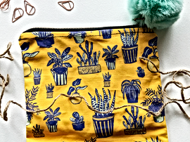 Last year I designed fabric and learned how  to sew these fun pouches. Please see my ETSY shop if interested.