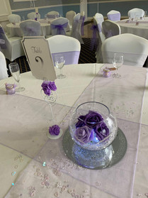 purple goldfish bowl and mirror plate centerpiece