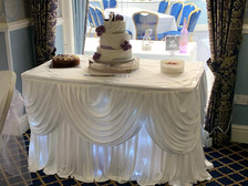 wedding cake table skirting and swag with twinkle lights