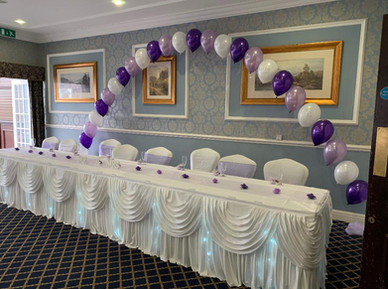 wedding top table twinkle skirt and swag with balloon arch