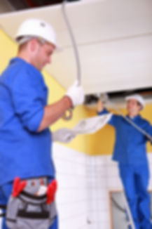 Electricians installing electrical cabli