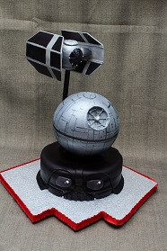 Star Wars creation cake with hollow chocolate death star filled with candy and LED light