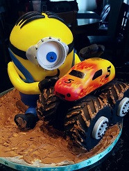 Minion cake with edible monster truck