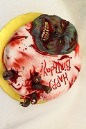 Zombie sculpted face cake