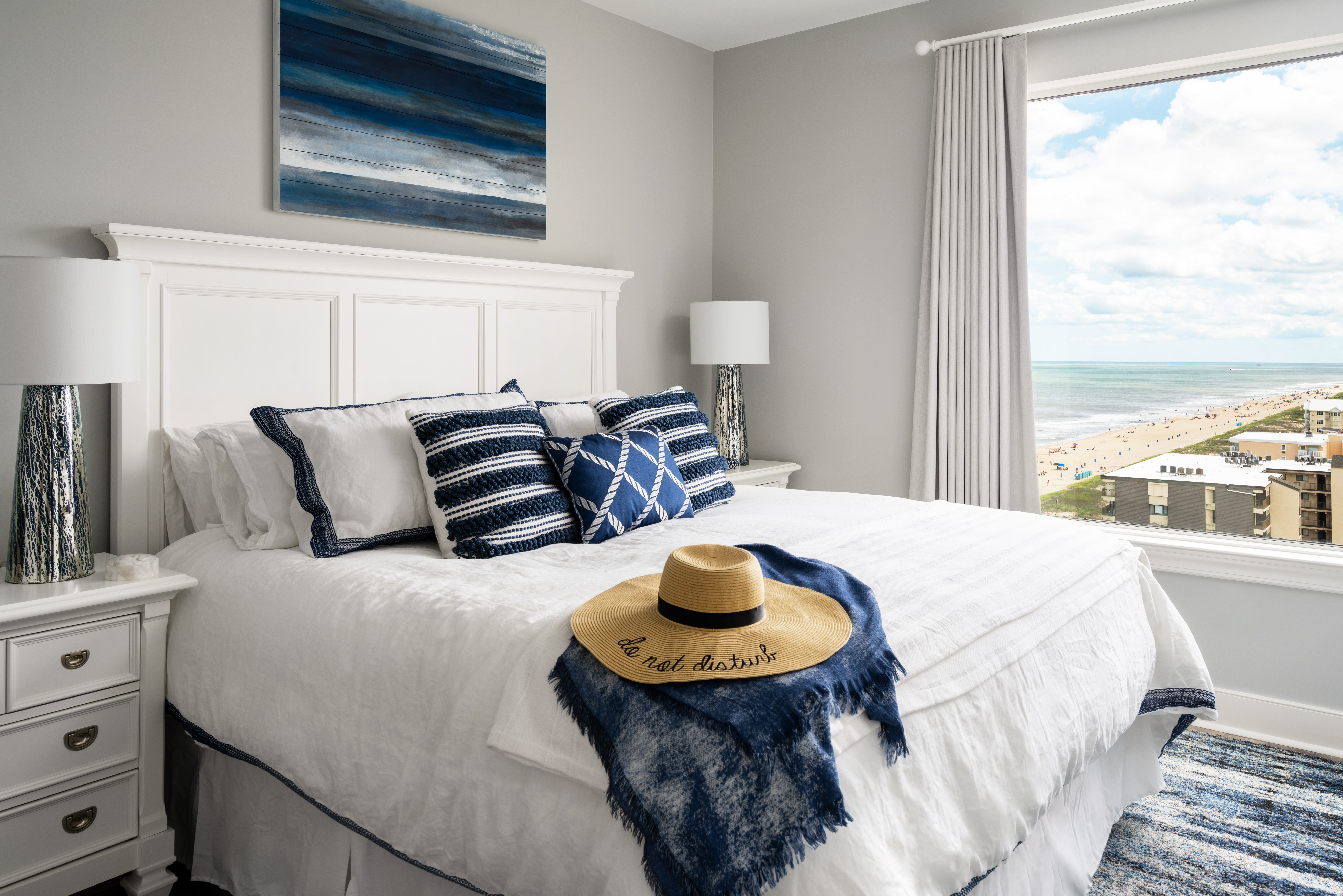 navy and white guest room