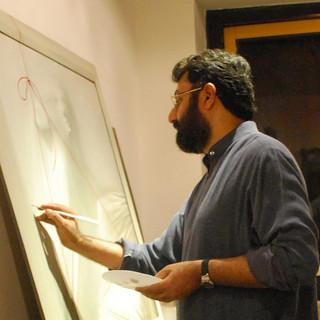 Eminent artist Vijender Sharma giving final touches his work at ArtDesh Gallery.