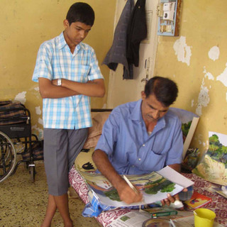 Ailing artist late Mr J Deshmukh  from Kolhapur painting while undergoing treatment. He was financially supported.