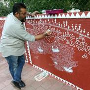 Artist painting the Walkeshwar wall