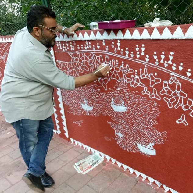 Artist painting the Walkeshwar wall