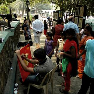 Live art demonstration by an artist at the Navi Mumbai Art Festival held by ArtDesh in 2013 in Navi Mumbai .