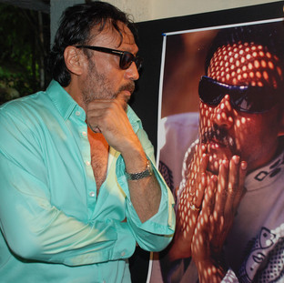 Celebrity Bollywood artist Jackie Shroff looking at his own image at Navi Mumbai Photo Festival held in 2014.