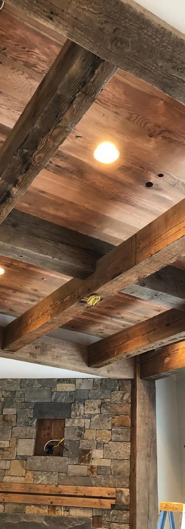 Master bedroom reclaimed beams