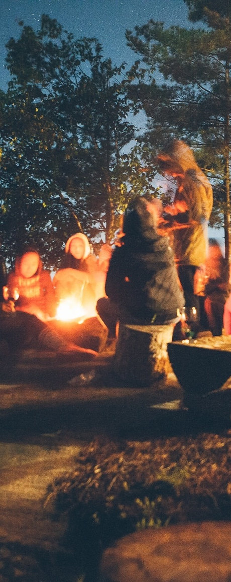 group of people near bonfire near trees during nighttime_edited_edited.jpg