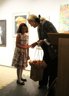 Princess Michael receiving flowers from