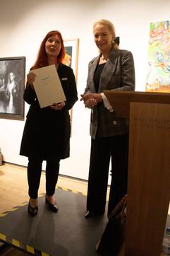 Arina Gordienko receiving her award from