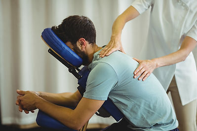 Physio treating shoulder back injury