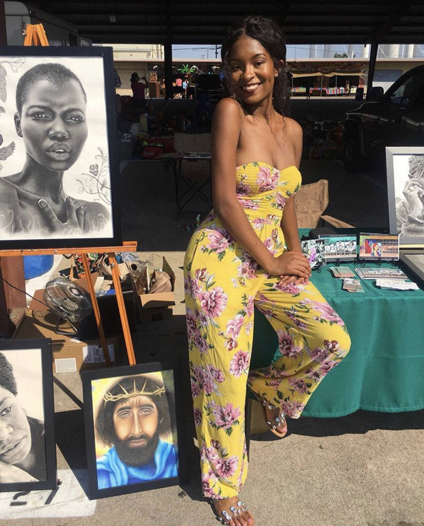 Art sale at traders village, hyperrealistic portraits by artist Tiffany Anderson