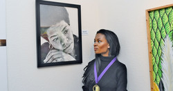 Lenora Rolla Heritage Museum exhibit 2017 Tiffany anderson next to her portrait of maya angelou