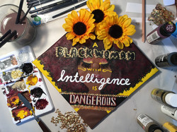 A black woman with intelligence is dangerous, sunflower and lashes and afro graduation cap custom de