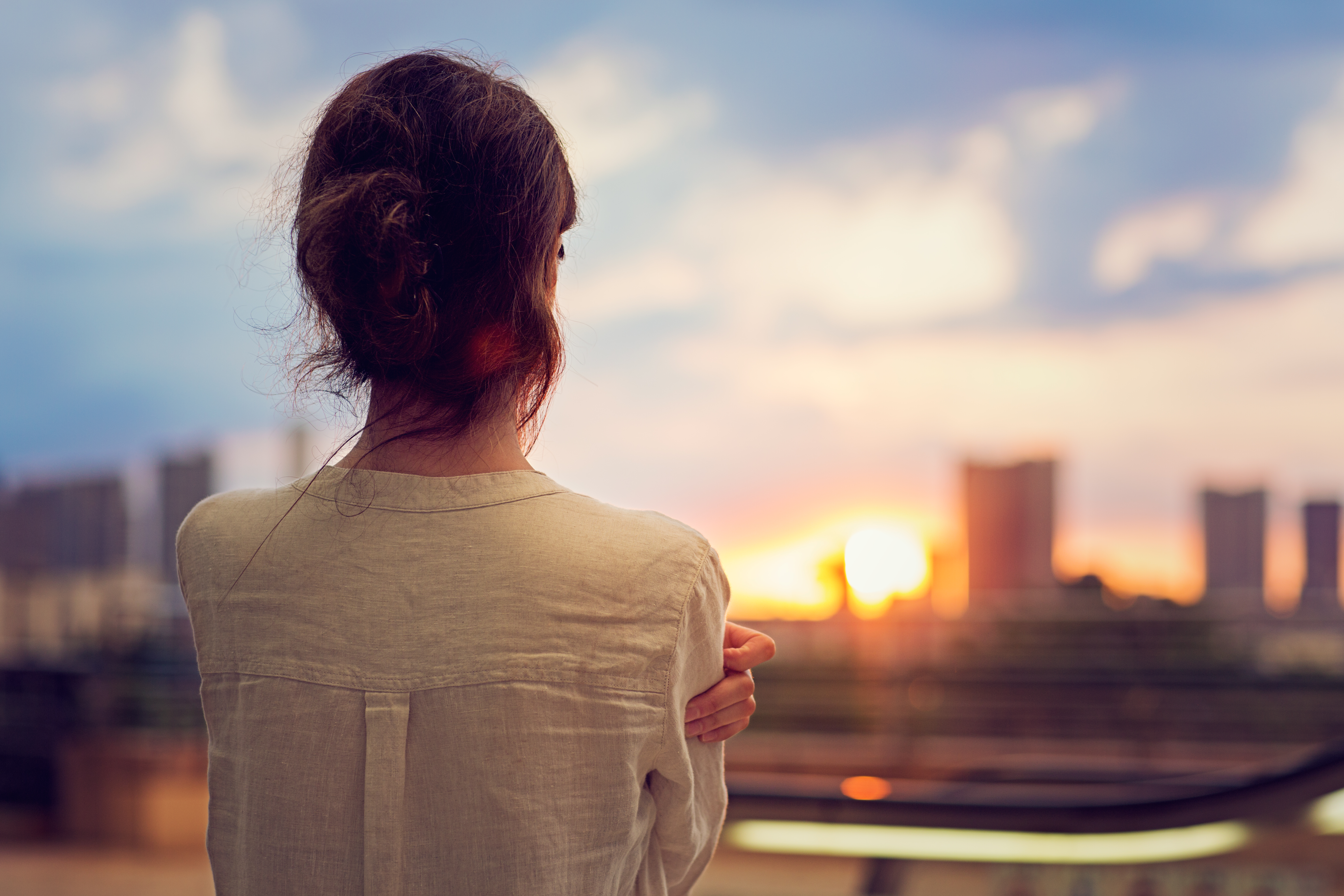 Young-girl-is-watching-sunset-over-Tokyo-541836000_6144x4096