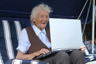 senior citizen on apple mac