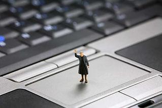 woman standing on macbook pro