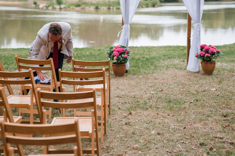 Guest drying seats before ceremony
