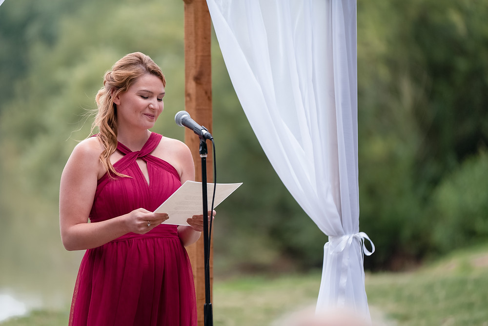 Bridesmaid in burgundy giving reading