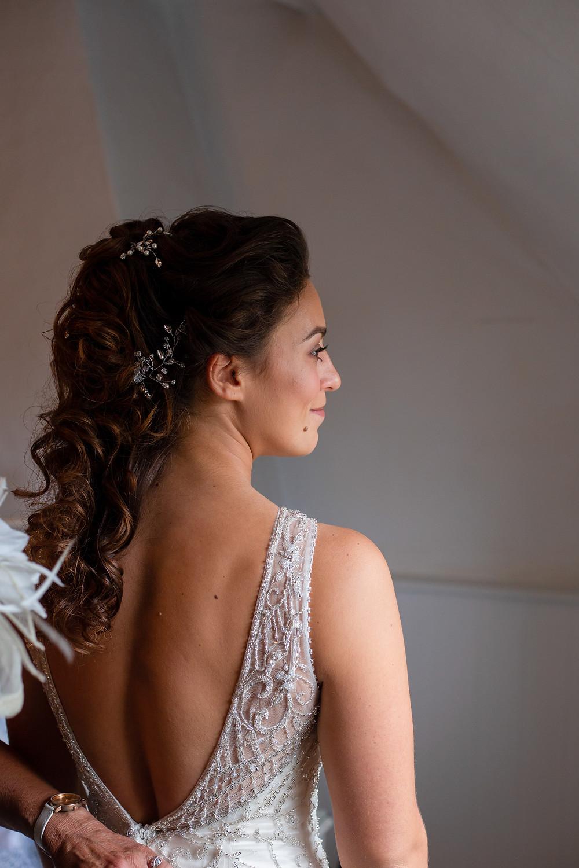 Side profile of bride in dress