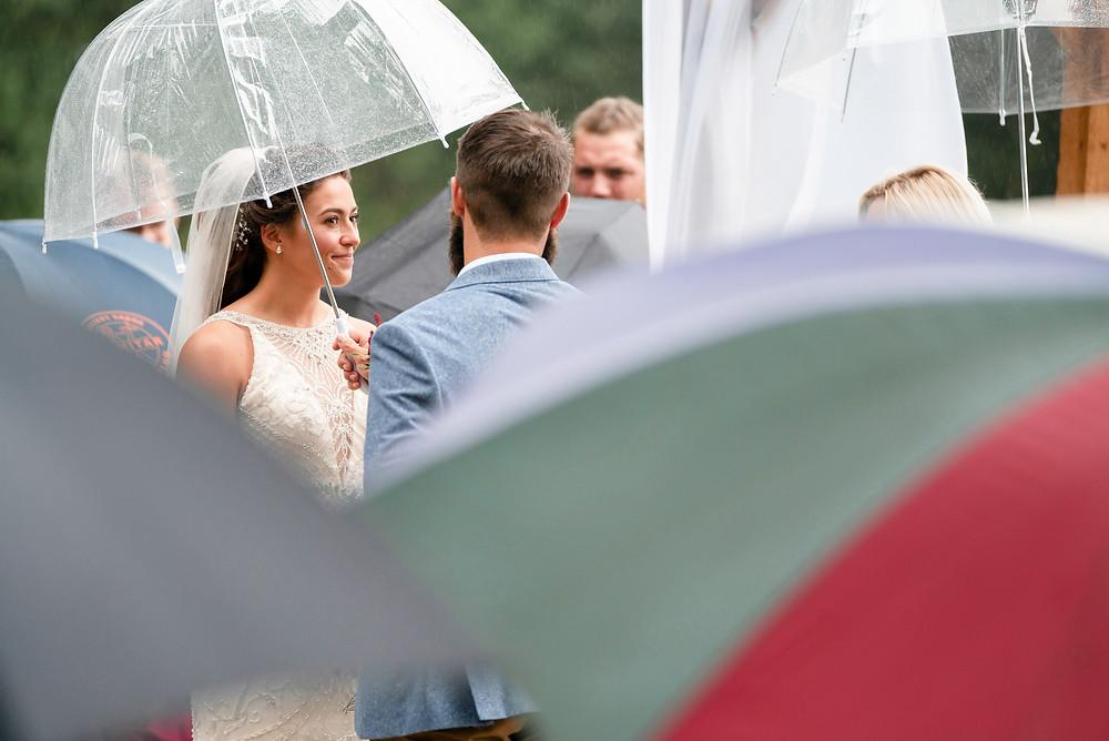 Arty shot of rainy outdoor wedding ceremony