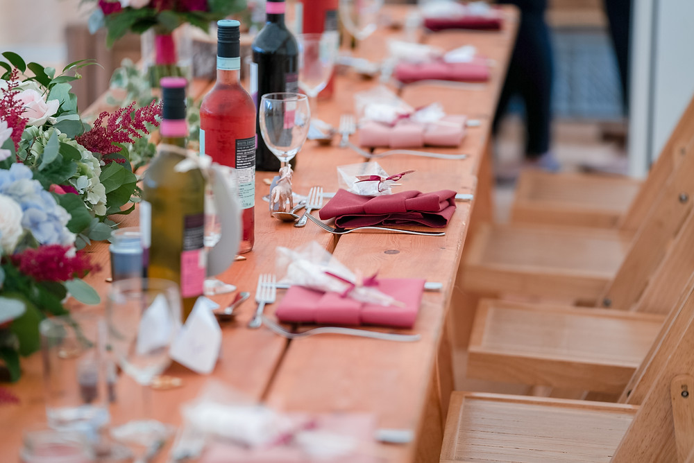 Wine and marshmallow favours on tables