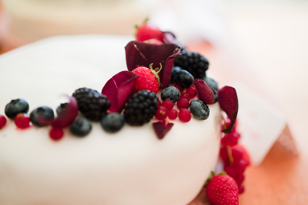 Homemade white cake with berries