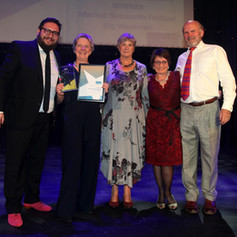 Committee members collect the award for Favourite Festival with Free Entry from the Leicestershire Tourism and Hospitality Awards 2018