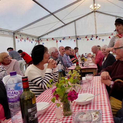Fifi La Mer serenades diners at the French Evening, 21st June 2019