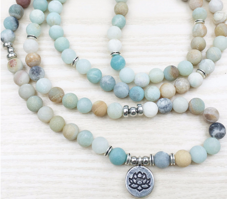 Buddhist beads with lotus flower charm