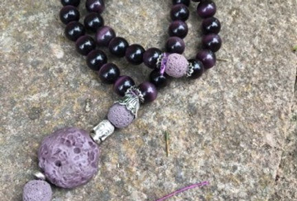 Mala praying beads with Buddha and Cat Eye in purple
