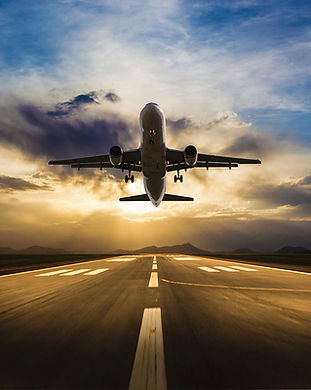 passenger-airplane-taking-off-at-sunset-