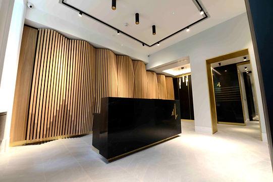 Granite reception desk with oak feature