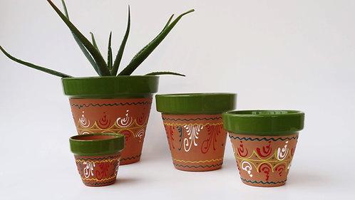 Groene terracotta bloempot