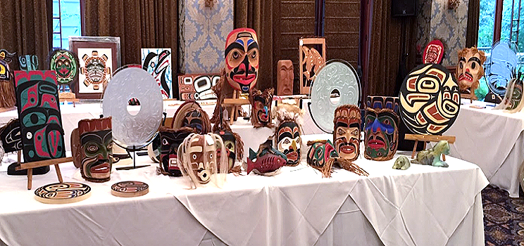 Silent and Live Auction Display West Coast First Nations Ceramics, Glassworks, Prints, Paintings. Paddles, Oars, Panel