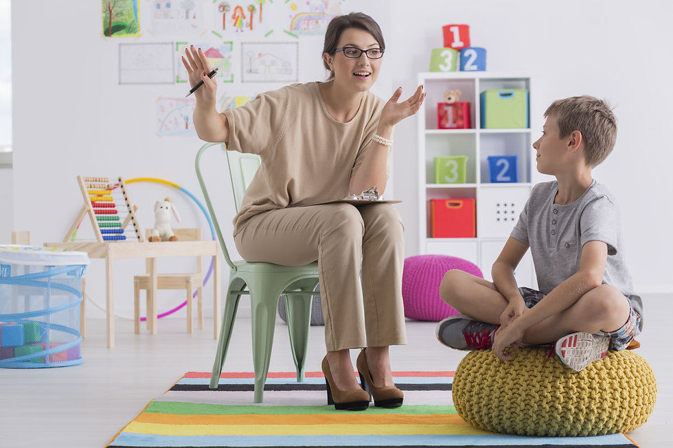Positive school counselor and pupil sitt