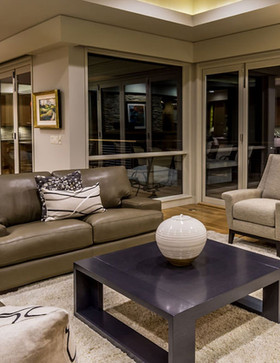 The color and texture palette for the interior of this custom home offers a neutral richness, allowing the client's art collection and the beautiful architectural detail to take center stage.